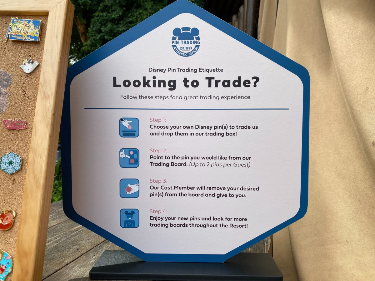 pin trading etiquette sign
